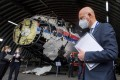Presiding judge Hendrik Steenhuis and other judges and lawyers view the reconstructed wreckage of Malaysia Airlines flight MH17, at the Gilze-Rijen military airbase, in May. Photo: AFP