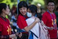 A student hugs her teacher at an exam centre in Guiyang, the capital of southwest China's Guizhou province, on June 7, the first day of China's annual college entrance exam. Photo: Xinhua