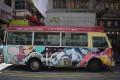 A Hong Kong minibus carries a collage of artworks by street artists Kalacove, Bao Ho, Takamitsu Takagaito and Zoie Lam. Photo: eicó