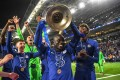 Chelsea's French midfielder N'Golo Kante lifts the trophy after winning the 2020-21 Uefa Champions League. Photo: AFP