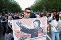 A protester holds a placard depicting Hungary's Prime Minister Viktor Orban as Mao Zedong during a protest on June 5 against a planned Fudan University campus in Budapest. Photo: Reuters