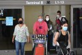 Travellers exit the terminal on arrival at Los Angeles International Airport ahead of the recent Memorial Day weekend. US flight capacity has rebounded with the rapid rollout of Covid-19 vaccination. Photo: AFP