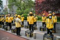 Food delivery couriers for Meituan during a morning briefing in Beijing in April. Photo: Bloomberg