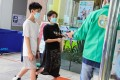 A parent and child arrive at the Sun Yat Sen Memorial Park Sports Centre to get the BioNTech vaccine. Photo: Nora Tam