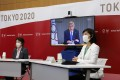President of Tokyo 2020 Seiko Hashimoto, IOC President Thomas Bach (on screen) and Minister for the Tokyo Olympic and Paralympic Games, Tamayo Marukawa speak during a five-party meeting in Tokyo on June 21. Photo: EPA-EFE