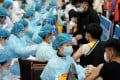 A new estimate says up to 2.2 billion vaccine doses will need to be administered in China to achieve herd immunity. Photo: Reuters