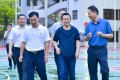 Zhang Yiming (second from right) seen visiting his old school, Yongding No 1 Middle School in Fujian, in June. Photo: Handout