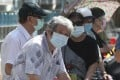 Elderly Taiwanese people line up to have the AstraZeneca Covid-19 vaccine at a primary school in Taipei. Photo: AP