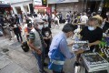 Hongkongers queue to purchase the last edition of Apple Daily on Thursday morning in Mong Kok. Photo: Felix Wong