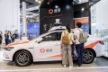 An autonomous vehicle branded with Didi Chuxing's sign at the World Artificial Intelligence Conference (WAIC) in Shanghai on Thursday, August 29, 2019. Photo: Bloomberg