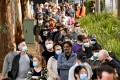 Residents queue outside a vaccination centre in Sydney on Thursday. Photo: AFP