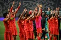 China's team celebrate their victory during the qualifying play-off second leg women's football match for the Tokyo 2020 Olympic Games between China and South Korea at Suzhou Olympic Sports Centre Stadium in Suzhou. Photo: AFP