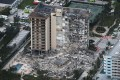 The condominium was built in 1981. About 50 of its roughly 130 units were involved in the collapse. Photo: AFP