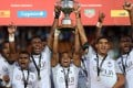Fiji players celebrate winning the World Rugby Sevens Series trophy after a match against the US at the Waikato Stadium in New Zealand in 2019. Photo: AFP
