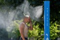 A man cools off at a misting station in Vancouver, British Columbia, Canada. Photo: Reuters