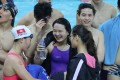 Chloe Cheng (purple swim suit) celebrates with teammates after breaking the Hong Kong record in the women's 400m individual medley at Victoria Park. Photos: Nora Tam