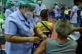A nurse administers a dose of a Covid-19 vaccine at a hospital in the southern province of Narathiwat on June 7. Less that 5 per cent of Narathiwat and Yala's 1.1 million population have received a jab so far. Photo: AFP
