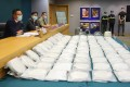 Hong Kong customs officials with some of the 110kg of cocaine seized in an operation at the city's international airport. Photo: May Tse