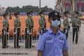 A policeman stands guard as paramilitary officers prepare for the anniversary events at Tiananmen Square on Monday. Photo: AP