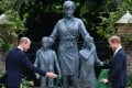 Princes William (left) and Harry unveil a statue of Princess Diana at the Sunken Garden in Kensington Palace on Thursday. Photo: AFP