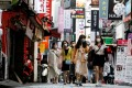 People walk through the Myeongdong shopping district of South Korean capital Seoul in May. Photo: Reuters