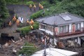 Rescuers search for missing people after a mudslide triggered by torrential rain at Izusan in Atami, Shizuoka Prefecture, central Japan. Photo: EPA-EFE