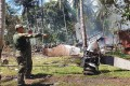 """Philippine military officials inspect the scene after an air force C-130 transport plane crashed near the airport in Jolo town, Sulu province. Photo: AFP."""""""