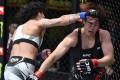Virna Jandiroba punches Kanako Murata in their strawweight bout at UFC Vegas 29. Photo: Chris Unger/Zuffa LLC