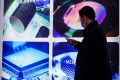 A man visits a display at Semicon China, a trade fair for semiconductor technology, in Shanghai in March. Photo: Reuters