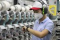 """A worker at Esquel Group's spinning mill in Changji county in the Xinjiang Uygur autonomous region. Esquel has sued the US seeking removal from the Commerce Department's """"entity list"""". Photo: Handout"""
