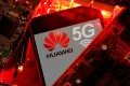 A smartphone with the Huawei and 5G network logo seen on a PC motherboard in this illustration picture taken January 29, 2020. Photo: Reuters