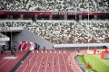 Japanese athletes compete in front of empty seats at the National Stadium in a test event for the 2020 Olympic Games. Photo: AP