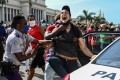 A protester is arrested during a demonstration against the government of Cuban President Miguel Diaz-Canel in Havana, Cuba on Sunday. Photo: AFP