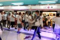 A mob of men in white T-shirts attacked protesters and passengers in Yuen Long MTR station. Photo: SCMP Pictures