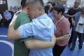 The moment a father and mother are reunited with their missing son 24 years after he was abducted. Photo: CCTV