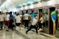 A white-clad mob attacks protesters and commuters at Yuen Long MTR station on the night of July 21, 2019. Photo: Handout