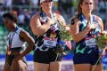 US hammer thrower Gwen Berry (left) turned away while the national anthem played at the Olympic trials. Photo: AFP