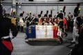 Men dressed as Napoleon-era fighters walk towards a French flag-covered coffin containing the remains of late French General Charles Etienne Gudin during a ceremony at Le Bourget airport near Paris on Tuesday. Photo: AFP