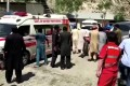 People wheel a gurney towards an ambulance outside a hospital in Dasu, after a bus with Chinese nationals on board plunged into a ravine in Kohistan, Pakistan, following a blast. Photo: Reuters