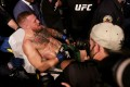 McGregor is carried out of the T-Mobile Arena on a stretcher after breaking his leg in the first round of his lightweight bout against Dustin Poirier. Photo: AFP