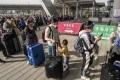 Travellers depart Hong Kong for mainland China at the Shenzhen Bay border crossing in December last year. Photo: Felix Wong