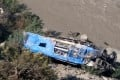 The wreckage of the bus that plunged into a ravine following the Wednesday blast. Photo: Xinhua
