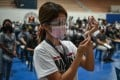 A health worker prepares a dose of the Pfizer Covid-19 jab at a vaccination centre in Manila, Philippines. Photo: AFP