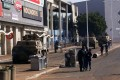 Military tanks patrol near a shopping centre damaged after several days of looting following the imprisonment of former South Africa President Jacob Zuma in Durban, South Africa. Photo: Reuters