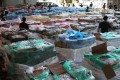 Thousands of tonnes of seized contraband meat are displayed by customs officials last year. Sources say triads are believed to be smuggling as much as 1,000 tonnes of meat a day to mainland China. Photo: Edmond So