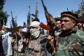 Armed individuals gather to pledge their support for Afghan security forces and fight against the Taliban. Photo: Reuters