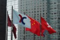 The flag of Hong Kong Exchanges & Clearing Ltd. (HKEX) displayed at the Exchange Square complex in Central. Photo: Sam Tsang