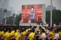 Chinese President Xi Jinping pictured on a screen in Tiananmen Square as he delivers his speech to mark the party's centenary. Photo: AFP/Getty Images