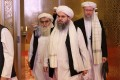 Members of the Taliban delegation arrive for peace talks between the Afghan government and the Taliban in Doha, Qatar on Sunday. Photo: AFP