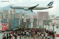 Residents watch airlines approach Kai Tak International Airport on June 28, 1998, one week before it was closed. Photo: SCMP
